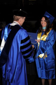 Photo of distance learning student at graduation