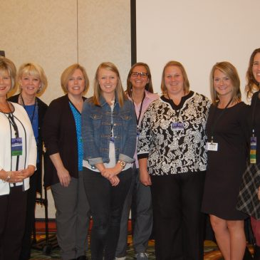 photo of faculty members at conference