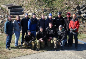 Professor Mark Abel, graduate students and SWAT team members pose for a photo after completing research for the day.