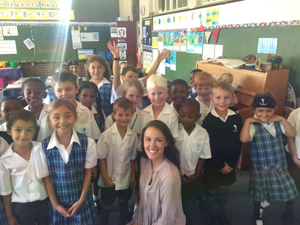 photo of Courtney Eaton with South African students