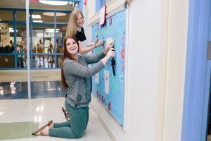 students doing bulletin board photo