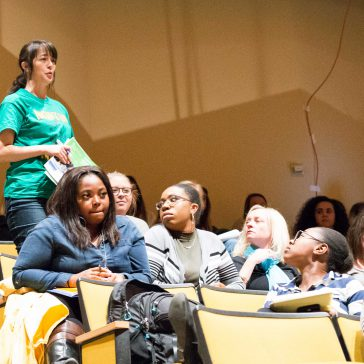 photo of student asking question at panel discussion