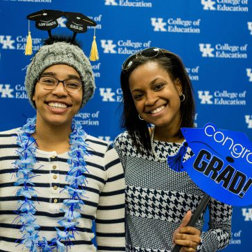 students at Commencement reception photo booth