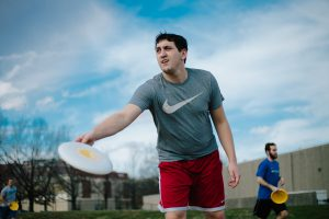 photo of male playing frisbee