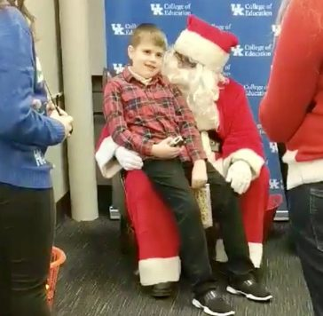 boy sitting with Santa