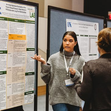 Photo of student presenting at Spring Research Conference