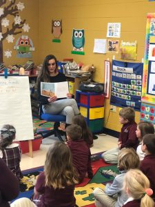 Shelly Krajny reading to a group of children in a classroom