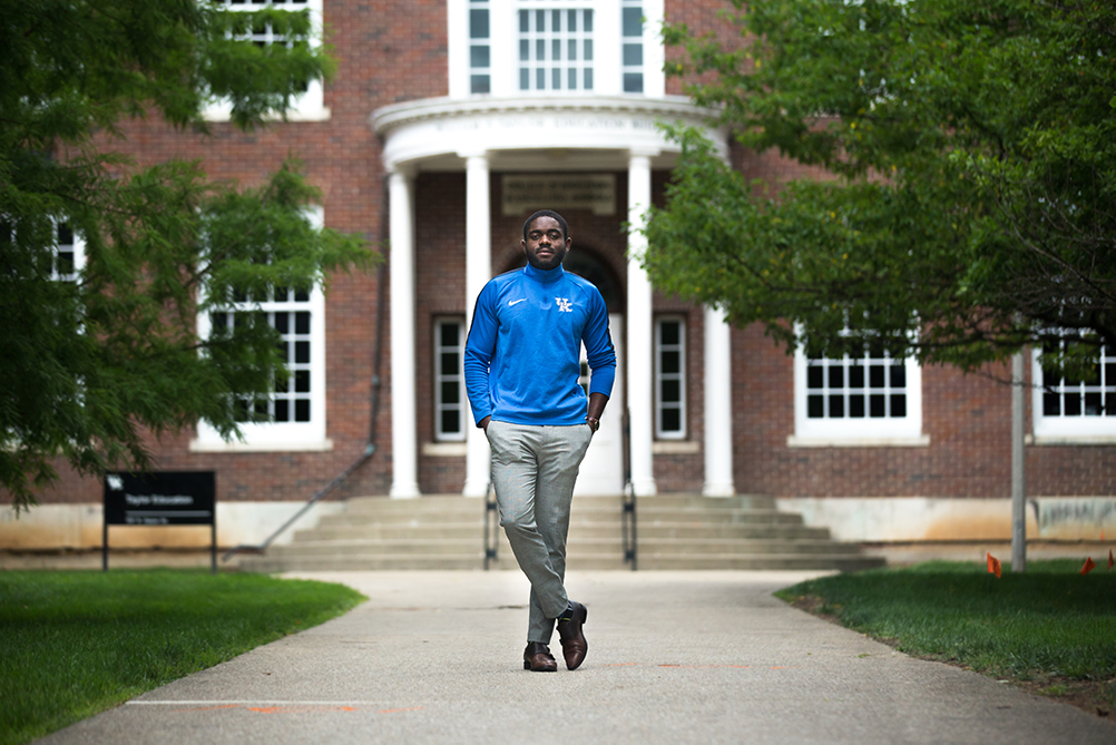 photo of Arsene Kabeya standing in front of Taylor Education Building