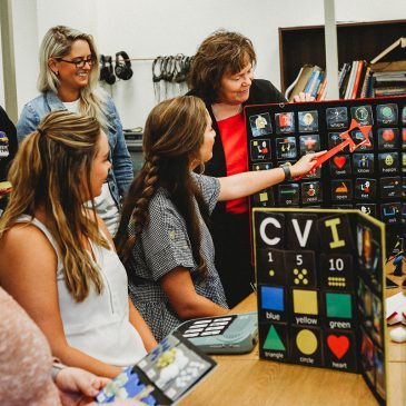 photo of students looking at visual aid in SPEAC it grant program