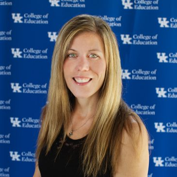 photo of Dr. Heather Erwin in front of blue backdrop