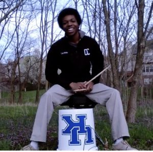 photo of Deandrae White playing bucket drums