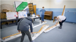 students building ramp to launch cars