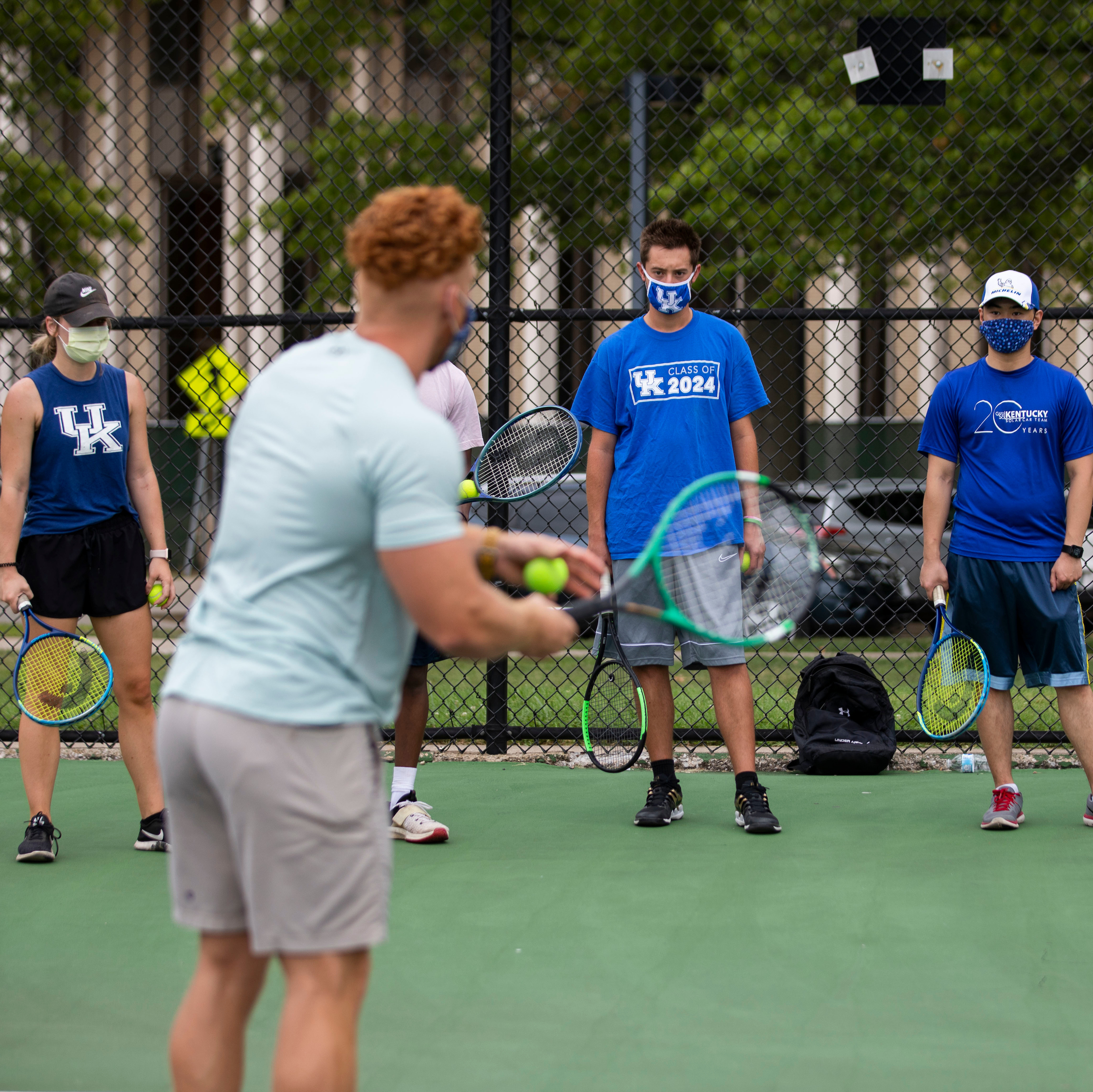 Tennis instructor teaching class